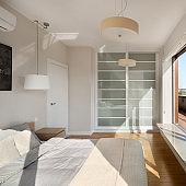 Spacious bedroom with big window