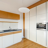 White kitchen with wooden elements