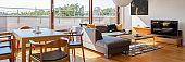 Living room with window wall, panorama