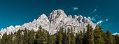 High Mountains Peak and Blue Sky. Wide Panoramic Image. Outdoor Adventure Panorama