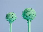 Set of paper cut green artichokes.