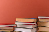 Stacks of books several on a brown background close-up. Back to school, education, learning,