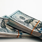 A bundle of one hundred dollar bills on a white background. Isolated