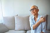 Senior woman with shoulder pain.