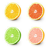 Isolated orange and lime. Several half ripe orange and lime isolated on a white background.