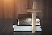 The crucifix is placed in the middle of the Bible. The idea of asking blessings from God with the power and power of holiness, which brings luck and shows forgiveness with the power of religion,faith.