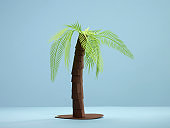 Palm tree paper cut on blue background