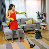 Mother and daughter cleaning the house