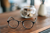 Stylish glasses on the wooden table in modern office room