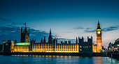 Westminster abbey and big ben in the London skyline at night, London, UK