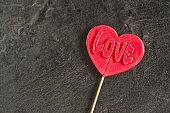 One red candy lollipop heart shape