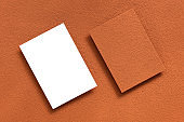 Blank business cards mockup sprinkled with cocoa powder. Creative abstract background. Modern Template for corporate identity. Cocoa powder texture. Top view.