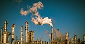 Smoke stacks and industrial pipes of Climate Change