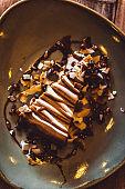 Raw Vegan Salted Caramel Cake with Liquid Chocolate Sauce and Crumble