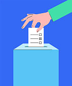 Voting concept with hand putting ballot into box