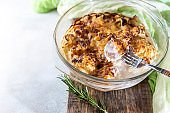 casserole from cauliflower with bechamel sauce in a glass baking dish.