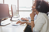 A female call center is talking to a customer.