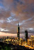 Panoramic cityscape of Taipei skyline and Taipei 101 Skyscraper at sunset scene.