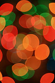 Vertical Image of Abstract Blurred Multi-color Glittering Illuminated Light on Black Background