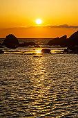 Orange sunrise reflected in the sea