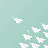 Group of paper planes flying. A paper plane ahead of other paper planes. Concept of leadership, innovation, change, disruption, risk, competition, mission. Vector illustration, flat design