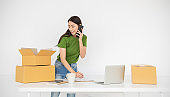 Startup small business entrepreneur SME, asian woman receive order on phone. Portrait young Asian small business owner home office, online sell marketing delivery, SME e-commerce telemarketing concept
