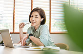 Portrait of beautiful business asian woman working in office desk using computer. Closeup woman with AirPods. Small business freelance girl. Business people employee, sme online marketing concept