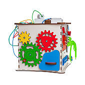children's educational toy busycube, busyboard, isolated on a white background, the development of motor skills and coordination in kids, design