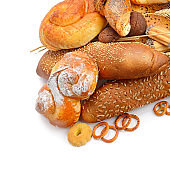 Assortment of bread, buns and croissant isolated on white background. Healthy food.