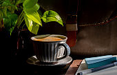 coffee break: notepad, briefcase and coffee on wooden table