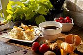 homemade breakfast: cheese bun, fried egg and coffee