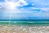 Sea view from tropical beach and sun . Outdoor travel.