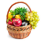 Vegetables and fruits in a basket isolated on white background. Healthy food.