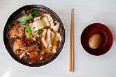 Chinese homemade noodles, with marinated egg, sliced meat, vegetable and spicy broth