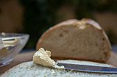 buttering on artisan crusty bread