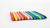 Colored pastel crayons on a white background. creativity, learning, arts and children's entertainment