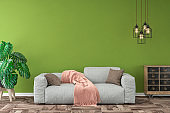 Empty living room with gray sofa, pendant lights and decoration