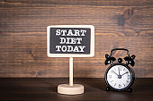 START DIET TODAY. Chalk board and alarm clock