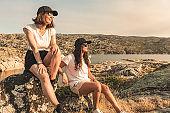 Two woman traveler watching sunset