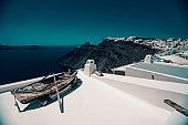 Boat On A Roof In Santorini, Greece Over A Beautiful View