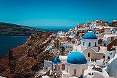 Sunny Hill And Blue Church In Oia, Santorini, Greece