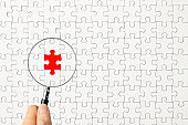 Search for missing last puzzle piece with a magnifying glass