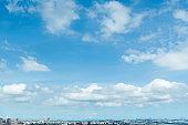 Landscape of city buildings under cloud sky