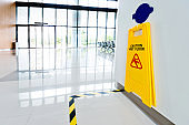 Wet floor sign hanging on the wall