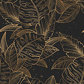 Seamless vector pattern with gold trendy exotic palm and monstera leaves isolated on black background. Elegant design for print, fabric, wallpaper, card, invitation