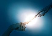 Human finger touching robot finger