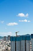 Construction site with crane under blue sky