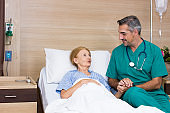 The internist asked about the illness and chat with the elderly woman in the recovery room.