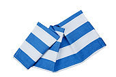Striped blue folded kitchen towel cloth top view isolated.