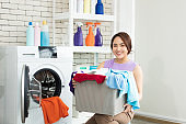 Asian women prepare to do the laundry.